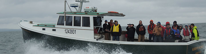 John Williams shuttles Eastern Maine Skippers Program students to North Haven for their presentation on flounder traps.
